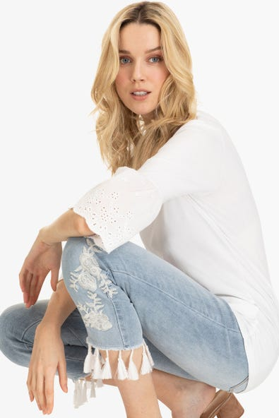 EMBROIDERED JEANS WITH TASSLE HEM